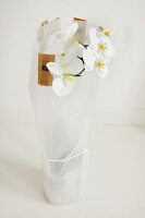 White orchid wrapped in bubble-wrap