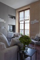 Living room with stone wall and period window