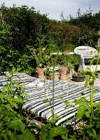 Idyllic seating area in garden with black and white striped futon sofa