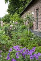 Landscaped garden outside brick house