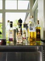 Bottles of vinegar and oil on surface