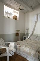 Vintage bedspread on double bed below small bed crown in simple bedroom