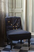 Antique chair upholstered using uniform jacket