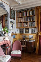 Bookcase, antique furniture and fireplace in classic living room
