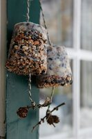 Birdcake moulded in flowerpots and hung up in feeding station