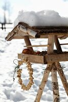 Wreath of peanuts hung from bird table