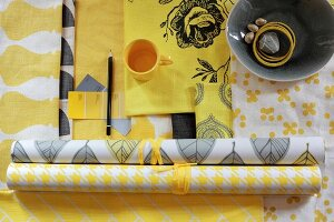 Wallpapers and fabrics in yellow and white patterns