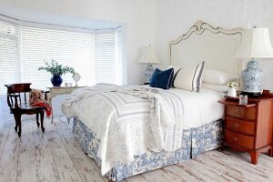 Classic bedroom with period furniture on old wooden floor