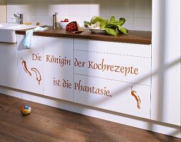 Kitchen cabinet doors and fronts revamped using wall stickers