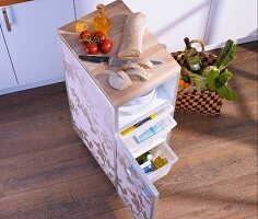 Handy kitchen cabinet on castors with extra storage room and worksurface
