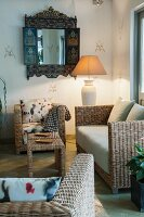 Modern wicker sofa set with plain and patterned seat cushions in rustic interior