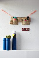 DIY containers made from plastic pipes, work-belt organiser and picture frame made from coloured power outlet panels