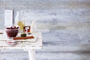 Homemade damson compote with flavouring ingredients