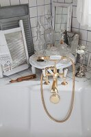Gilt, vintage bath tap fittings and vintage glass perfume bottles