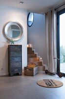 Filing cabinet and old wooden crate in industrial-style hallway