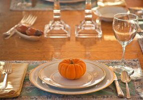 Autumnal place setting with pumpkin
