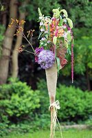Hand-crafted torch-shaped arrangement of garden flowers