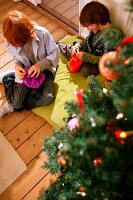 Children unwrapping Christmas gifts