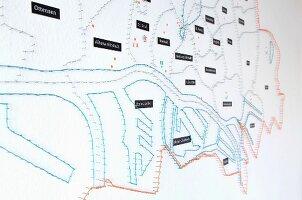Stylised string art map of Hamburg on white wall
