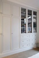 Fitted wardrobes painted white in elegant, country-house style