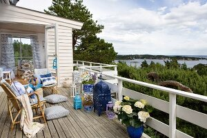 Maritime-style wooden terrace with view over lake landscape