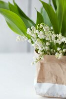 Lily of the valley in paper bag