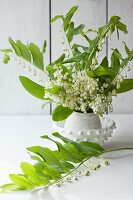 Vase of lily of the valley and white-flowered Solomon's seal