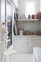 Vintage country-house-style utensils and shelf below window in former pantry