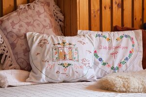 Vintage-style embroidered cushions