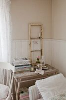 Window frame as shabby-chic decoration on old wooden table with patinated paint