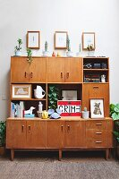 Retro living room cupboards in high-ceilinged room
