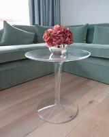 Corner sofa and small plexiglas Tulip table