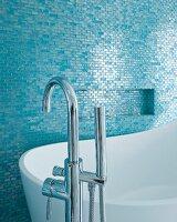 Designer bathtub and floor-mounted taps in elegant bathroom