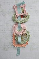Various pastel crocheted picture frames