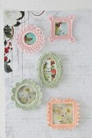 Pictures in crocheted frames hung on wall