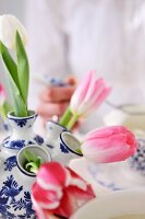Tulips in blue and white ceramic vase with multiple necks
