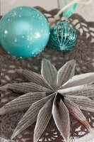 Paper star Christmas decoration made from folded book page