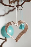 Heart-shaped Christmas-tree decoration made from old book pages