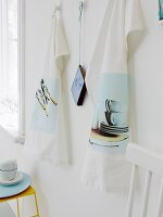 Photos of kitchen motifs as iron-on transfers on tea towels