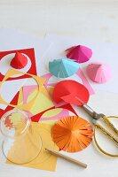 Hand-crafting paper umbrellas: cutting paper circles