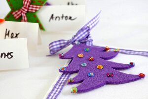 Felt Christmas tree decorated with sequins as festive napkin decoration