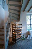 Vintage wooden crates below staircase