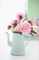 Pink peonies in white, vintage coffee pot