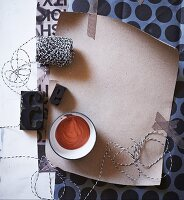 Black and white mood board of paper, washi tape, string and printing blocks