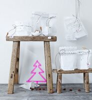 Advent calendar made from white paper bags with cut-out trim and cords with love-heart pendants