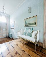 Antique furniture and old wooden floor in foyer