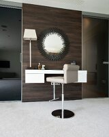 Luxurious dressing table with bar stool and large mirror on dark wooden wall