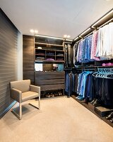 Luxurious dressing room with modern, open-fronted wardrobes