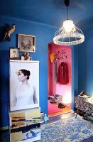 Fridge decorated with printed magnetic foil and wire lampshade with beaded edge in blue-painted hall