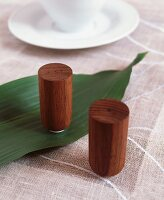 Wooden salt and pepper shakers on linen tablecloth